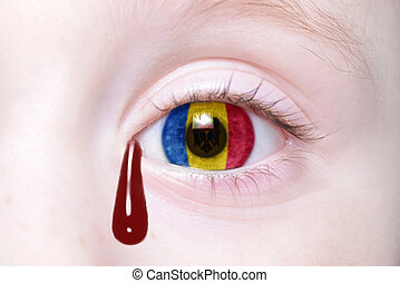 human's eye with national flag of moldova with bloody...