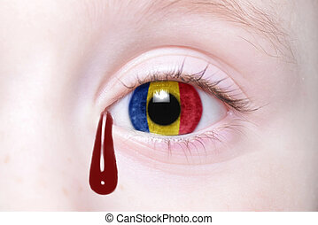 human's eye with national flag of romania with bloody...