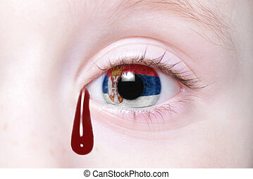 human and 39;s eye with national flag of serbia with bloody...