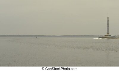 Motor boat far off on Dnieper river, Ukraine - Motorboat...