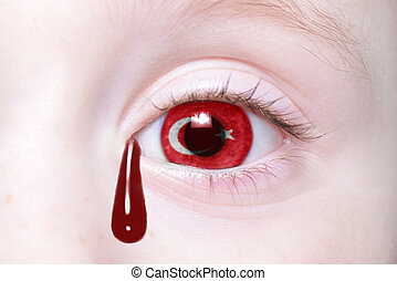 human's eye with national flag of turkey with bloody...
