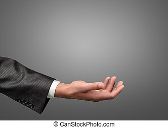 Hand of businessman palm up - A hand of a businessman in a...