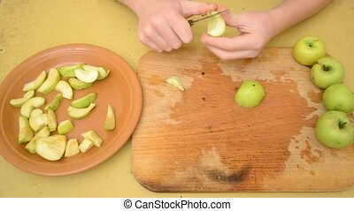 Removing apple kernels and cutting apples to slices -...