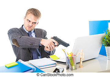overwhelmed businessman in upset face expression holding gun...