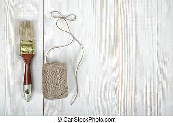 Top view of twine and brush on wooden DIY workbench with...