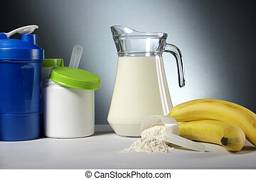 Sport Nutrition Supplement containers with jug of milk -...