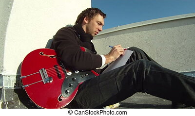 Musician invents a new song - The musician sits on the roof...