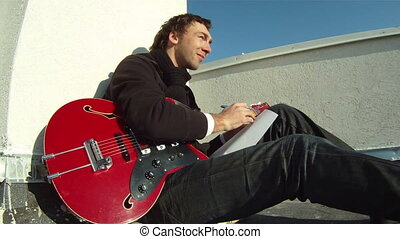 The musician is working on the roof - The musician sits on...