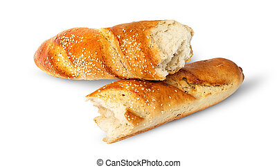 Two pieces of French baguette crosswise isolated on white...