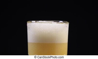 Cold Beer into Glass - Close-up process of beer pouring to...