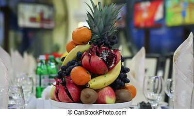 Decorative festive table with fruit Close-up