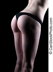 Woman in black panties bent over right  on black background