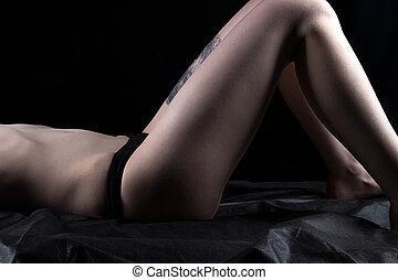 Lying woman in black panties
