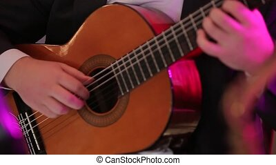 The Musician Playing the Guitar