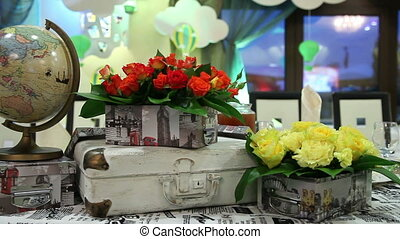Decorative festive table with yellow and red roses