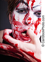 mime with blood on face and hand - Portrait of mime with...