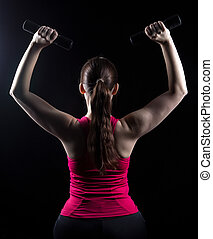 Fitness trainer with weights in the hands