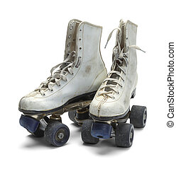 Old Roller Skates - Two Worn Roller Skates Isolated on White...