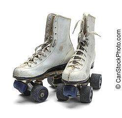 Old Roller Skates - Two Worn Roller Skates Isolated on White...