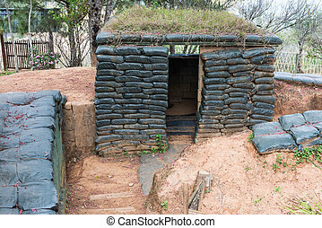 Cement shelter with sandbag of the old military base on the...