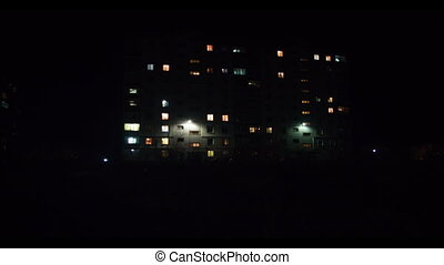 Multistorey Building with changing Window Lighting at Night. Time Lapse