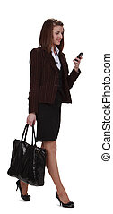 Mobile communication - Young businesswoman checking her...