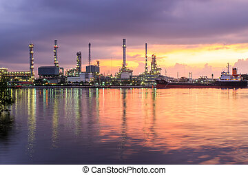 Oil refinery industry plant at dramatic twilight in morning