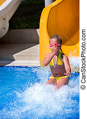 Kids pinch nose slide at aquapark Summer holiday