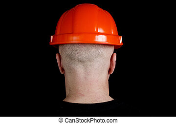 Construction worker in hard hat on gray background -...