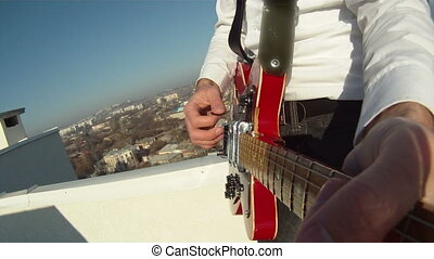 Man plays the guitar - A man plays the guitar on the...