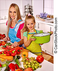 Mother and daughter cooking at kitchen. - Mother and...
