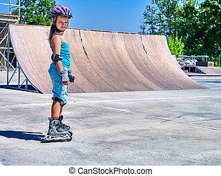 Girl riding on roller skates - Girl wearing protection...