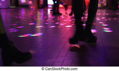 two women dancing in disco - two women in boots dancing on...