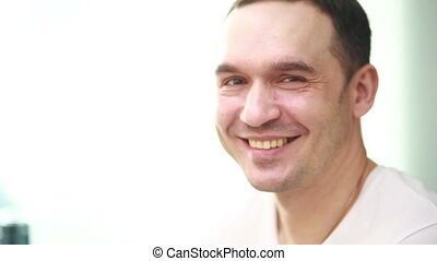 mature handsome man laughing portrait studio white...