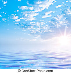 Summer sea landscape with the solar sky and beautiful clouds