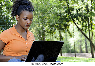 College Student - A college student working on a laptop