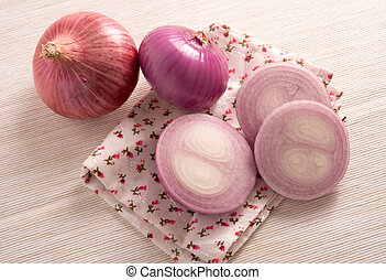 fresh red onion on a kitchen cloth