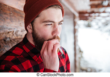 Man smoking cigarette outdoors