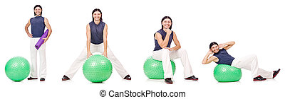 Man with swiss ball isolated on white