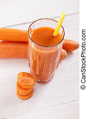 Carrot Juice - carrot juice on wooden table