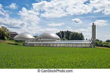 Biogas plant and greenhouse for solar sewage sludge drying...