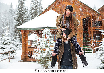 Couple having fun together in winter - Funny happy young...