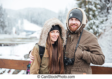 Couple with photo camera on winter mountain resort -...