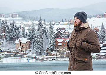 Man standing and enjoying the view on mountain resort -...