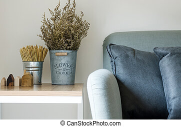 Modern sofa with dry flower in pot decorated on side table