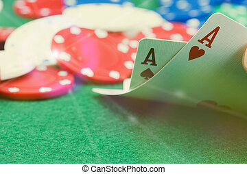 Poker chips and cards on a green table - Close up of poker...