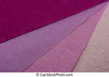 Close up of coloured paper