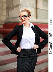Imposing girl student in business suit in front of...