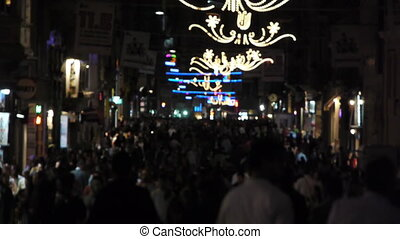 Crowded street at night - Thousands of people walking on a...