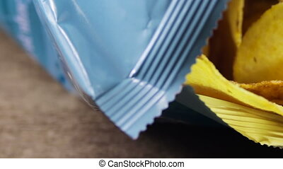Potato Chips in Package Rotating - Open package of potato...